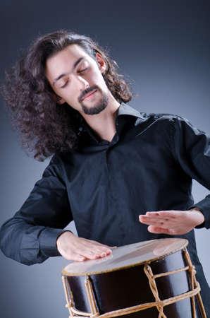 Man playing drum in studio Stock Photo - 12283849