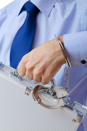 Businessman with handcuffs in concept photo