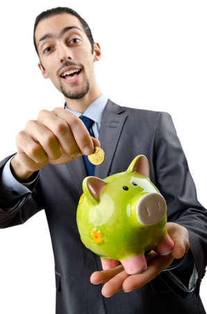 Man saving his money in the piggybank Stock Photo - 12283785