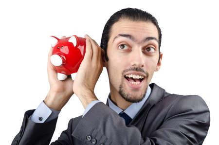 Man saving his money in the piggybank photo