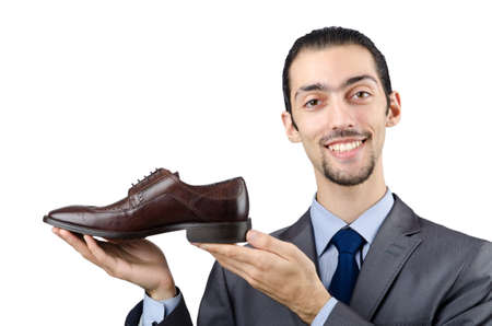 Man with a selection of shoes Stock Photo - 12283794