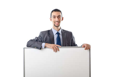 Young businessman with white board photo