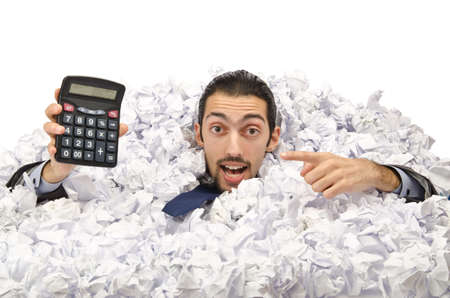 corporate waste: Man with lots of crumpled paper Stock Photo