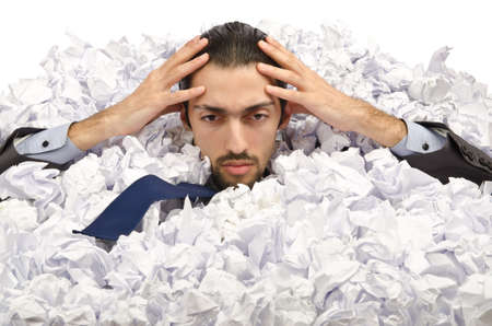 Man with lots of crumpled paper Stock Photo - 12283810