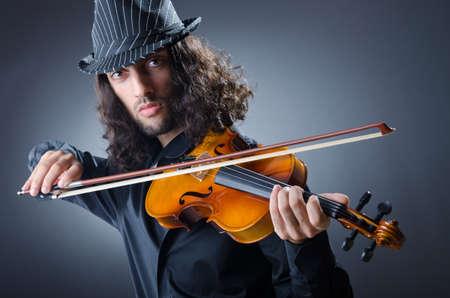 Gypsy violin player in studio photo