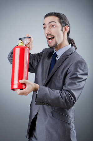 Man with fire extinguisher in firefighting concept Stock Photo - 12283842