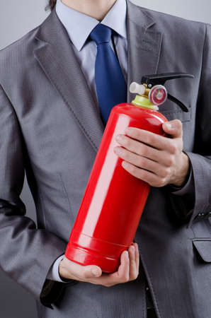 fire extinguisher: Man with fire extinguisher in firefighting concept
