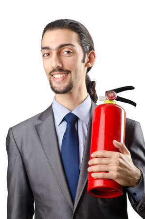 Man with fire extinguisher in firefighting concept Stock Photo - 12283850