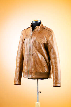coat rack: Brown leather jacket in fashion concept