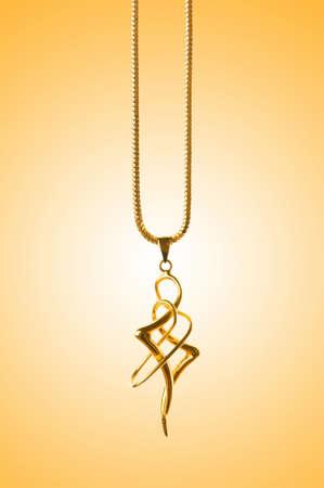 Golden jewellery against gradient background Stock Photo - 12228885