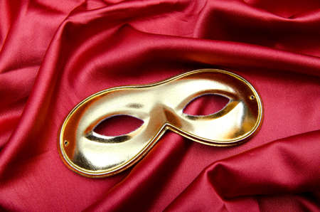 Carnical mask on satin background photo