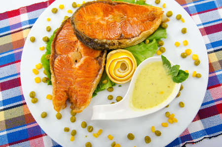 Roasted salmon in the plate photo