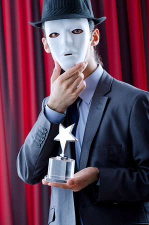 corporate espionage: Man receiving award in mask Stock Photo