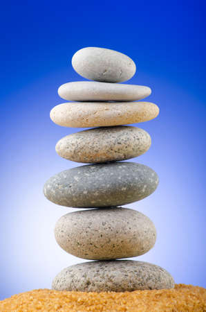 Balanced pebbles with colour background photo