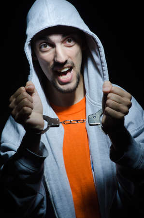 Young criminal with handcuffs Stock Photo - 12283802