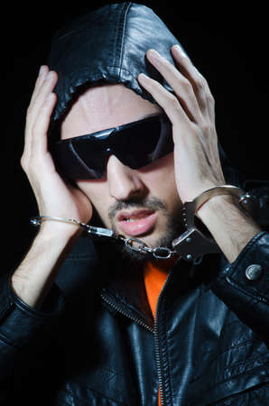 Young criminal with handcuffs Stock Photo - 12283822