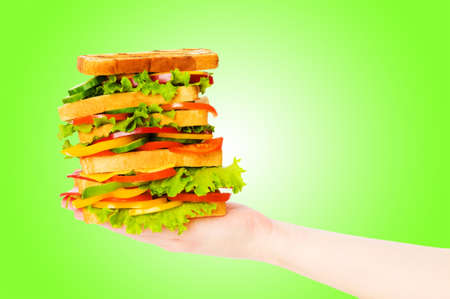 Giant sandwich against gradient background photo
