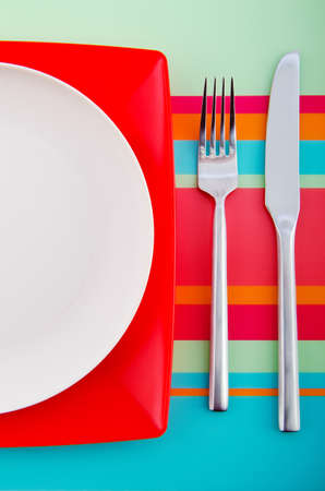 Empty plate with utensils Stock Photo - 12225928