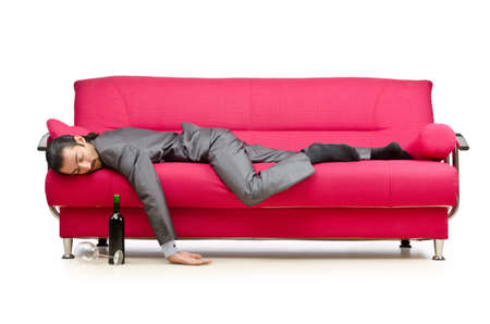 drunken: Man sitting in the sofa Stock Photo