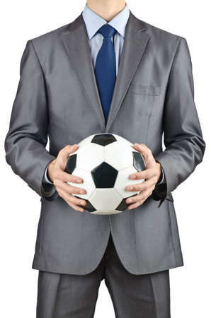 Businessman holding di calcio su bianco photo