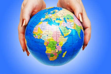 Hand holding globe against gradient Stock Photo - 12227899