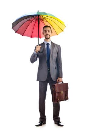 Businessman with umbrella on white photo