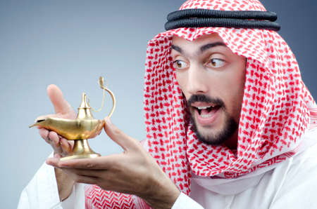 Arab and ancient golden lamp photo