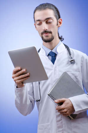 Doctor working on the tablet photo