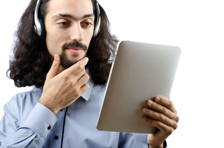Student listening music with tablet computer photo