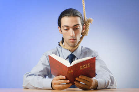 himself: Businessman reading bible before hanging himself Stock Photo