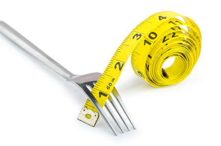 Dieting concept with fork and meter Stock Photo - 12225702