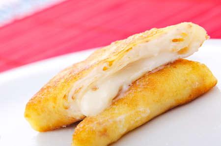 Custard filled pancake in plate photo