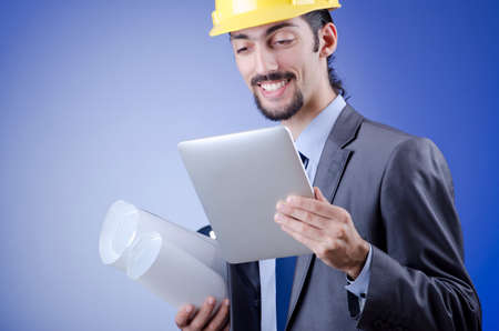 Construction worker working on tablet photo
