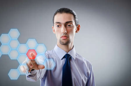 Businessman pressing virtual buttons photo