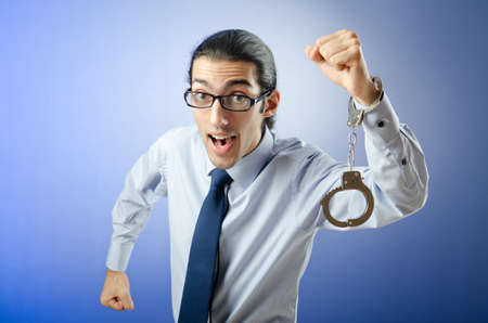 Businessman with handcuffs running away Stock Photo - 12395327