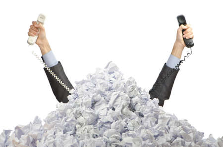 overload: Man with lots of crumpled paper Stock Photo