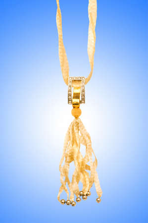 Golden jewellery against gradient background photo