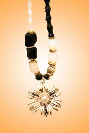 Golden jewellery against gradient background