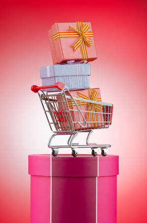 Christmas shopping concept with shopping cart photo