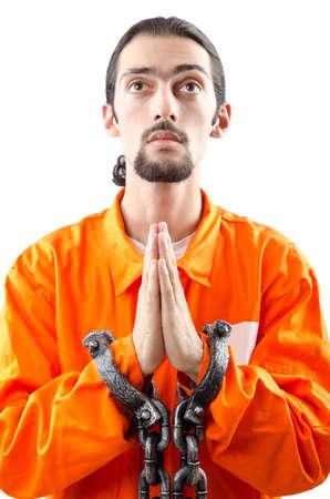 jailbird: Criminal in orange robe in prison