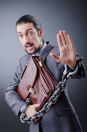 Arrested businessman in studio shooting Stock Photo - 12395499