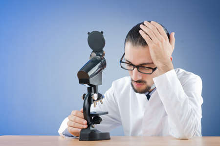 dissappointed: Chemist working with microscope