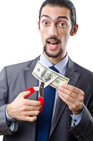 austerity: Man cutting money on white Stock Photo