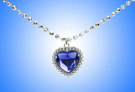 Silver pendant against gradient background photo