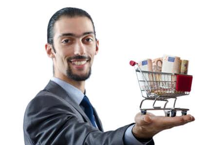 Shopping cart full of money photo