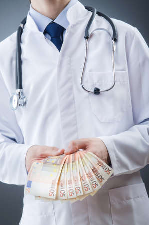 Doctor with euro money photo