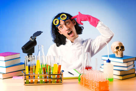 Chemist in the lab experimenting with solutions photo