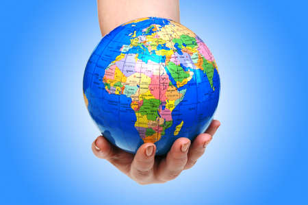 Hand holding globe against gradient Stock Photo - 12349374