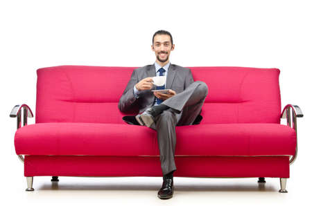 Man sitting in the sofa photo