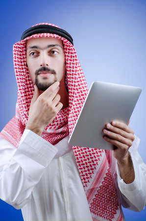 Young arab with tablet computer Stock Photo - 12472043